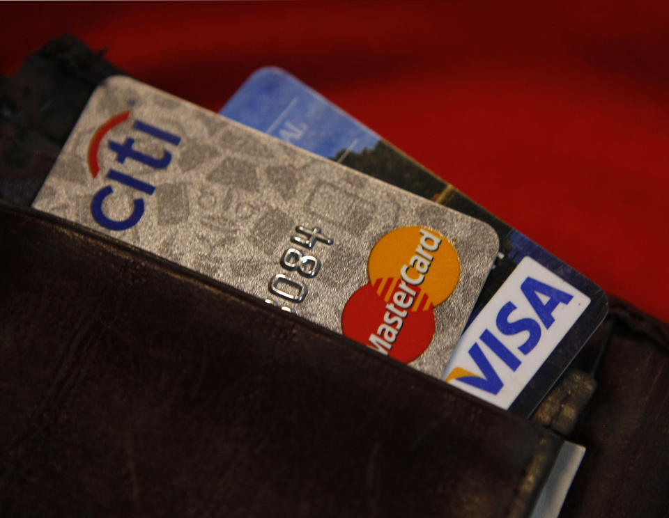 Credit cards are pictured in a wallet in Washington, February 21, 2010. (Photo: REUTERS/Stelios Varias)