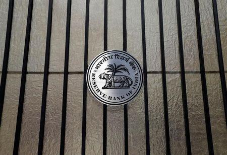 FILE PHOTO: A Reserve Bank of India (RBI) logo is seen at the entrance gate of its headquarters in Mumbai, India, June 7, 2017. REUTERS/Shailesh Andrade/File Photo