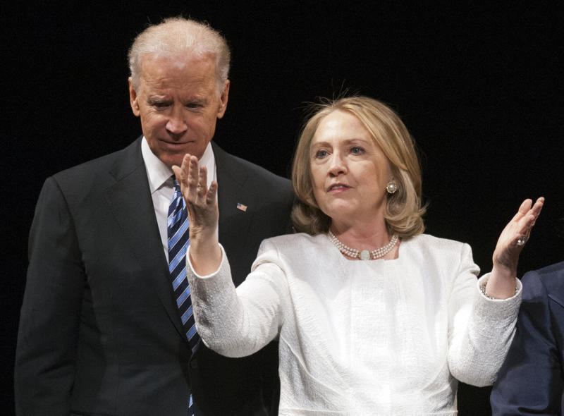 FILE - In this April 2, 2013, file photo Vice President Joe Biden and former Secretary of State Hillary Rodham Clinton are seen in Washington. Clinton, whose popularity is high when out of public office and who carries the scars of being seen as inevitable in 2008, is trying to strike the right careful balance between staying out of the daily political maelstrom and setting herself up for a possible second presidential run. Her fans and foes are making that difficult. (AP Photo/Cliff Owen, File)