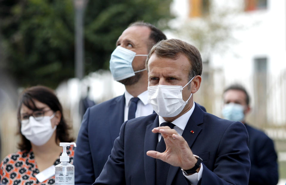 French President Emmanuel Macron gestures as he speaks to healthcare workers at the 'La Bonne Eure' nursing home in Bracieux, central France, Tuesday, Sept. 22, 2020. For the first time in months, virus infections and deaths in French nursing homes are on the rise again. (Yoan Valat/Pool Photo via AP)