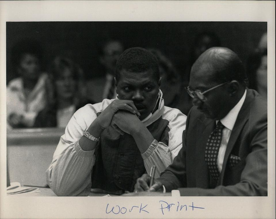 Lions defensive lineman Reggie Rogers speaks with his lawyer in court on Dec. 15, 1988.