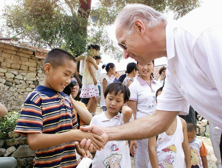 Biden greets young villager Gao Shan in 2001