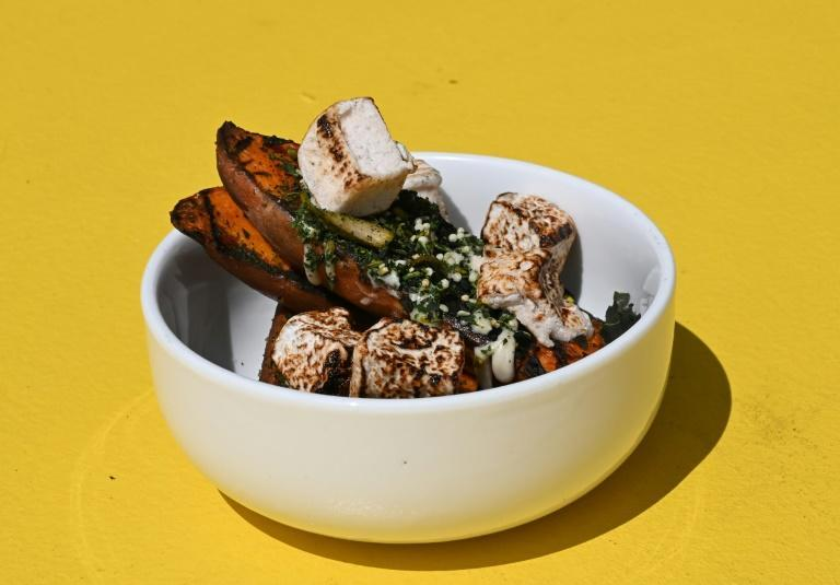 This dish featuring roasted sweet potato with collard furikake, sesame seed butter and caramelized anise spiced marshmallow is just one of numerous American culinary treats that trace their origins back to Africa