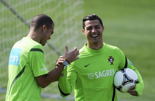 Portugal's defender Pepe (L) jokes with forward Cristiano Ronaldo