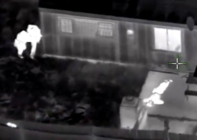 <p>Stephon Clark, 22, is visible on the ground after two police officers (L) shot him, in this still image captured from police aerial video footage released by Sacramento Police Department, Calif., on March 21, 2018. (Photo: Sacramento Police Department/Handout via Reuters) </p>