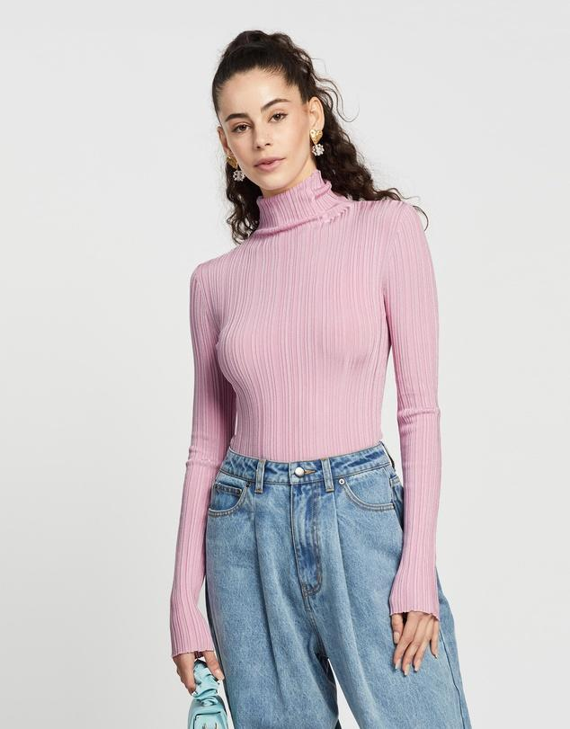 This pink turtle neck is down to $35.99 from $59.99. Photo: The Iconic