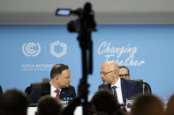 Michal Kurtyka, Polish Deputy Minister of the Environment and President of the COP24, right, talks to Andrzej Duda, President of Poland, left, during the COP24 United Nations Climate Change Conference in Katowice, Poland, Monday, Dec. 3, 2018. (Peter Klaunzer/Keystone via AP)