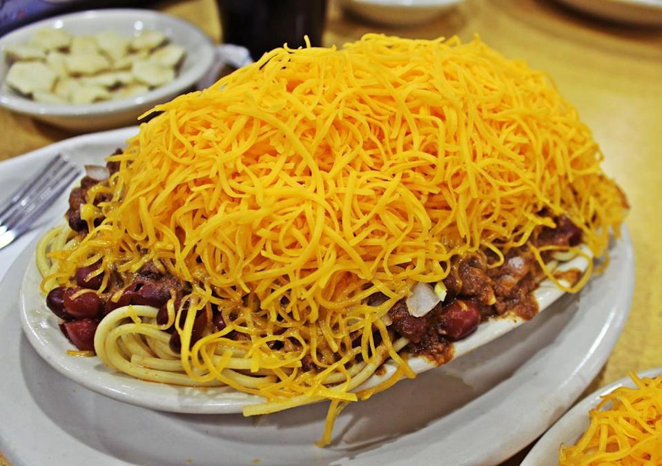 """<p>This Midwestern dish can be served with spaghetti and grated cheese topped over it. </p> <p><a href=""""https://www.thedailymeal.com/best-recipes/copycat-cincinnati-chili?referrer=yahoo&category=beauty_food&include_utm=1&utm_medium=referral&utm_source=yahoo&utm_campaign=feed"""" rel=""""nofollow noopener"""" target=""""_blank"""" data-ylk=""""slk:For the Cincinnati Chili recipe, click here"""" class=""""link rapid-noclick-resp"""">For the Cincinnati Chili recipe, click here</a>.</p>"""