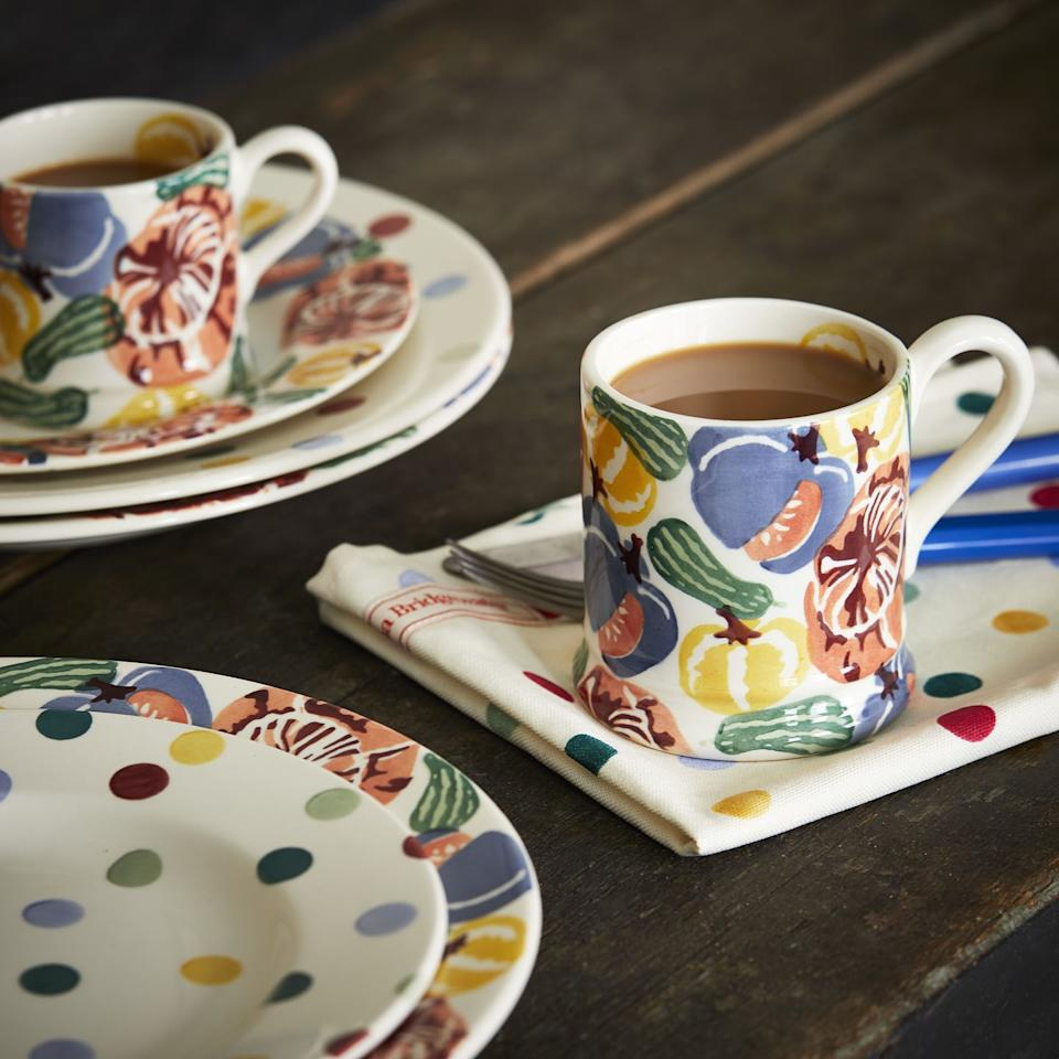 """<p>Get set for the spooky season with Emma Bridgewater's gorgeous new range of mugs. We love the brand new pumpkin prints, which include hues of yellow, blue and forest green. </p><p><a class=""""body-btn-link"""" href=""""https://go.redirectingat.com?id=127X1599956&url=https%3A%2F%2Fwww.emmabridgewater.co.uk%2Fproducts%2Ftumbling-pumpkins-1-2-pint-mug&sref=https%3A%2F%2Fwww.countryliving.com%2Fuk%2Fhomes-interiors%2Finteriors%2Fnews%2Fg130%2Femma-bridgewater-autumn-range%2F"""" target=""""_blank"""">BUY NOW, £19.95 </a></p>"""