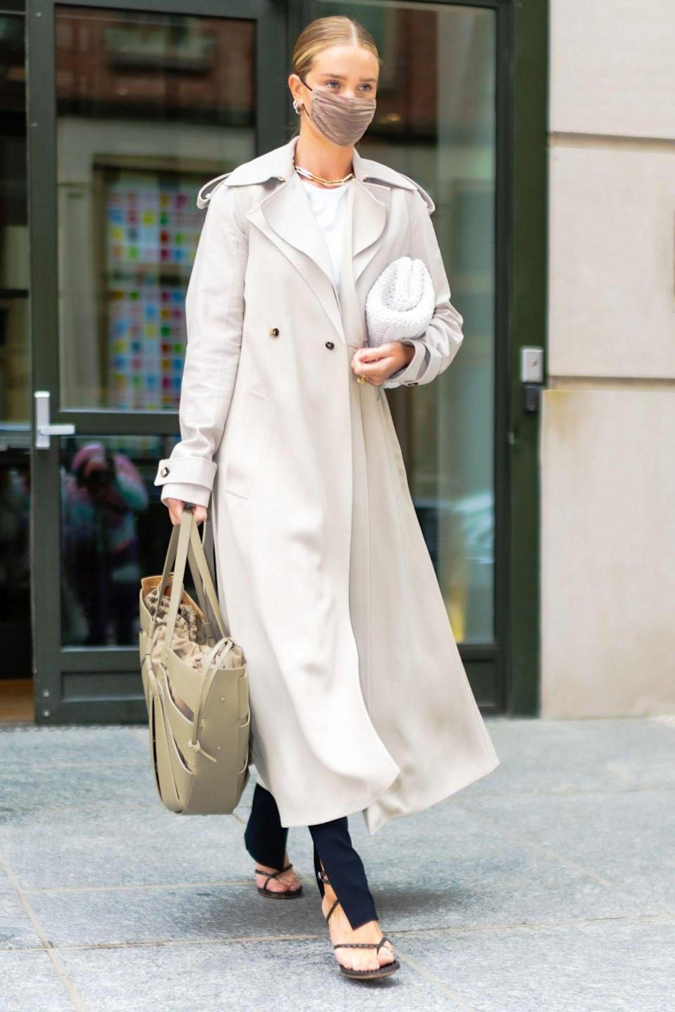 <p>Rosie Huntington-Whiteley leaves a building in New York City's SoHo neighborhood on Tuesday.</p>