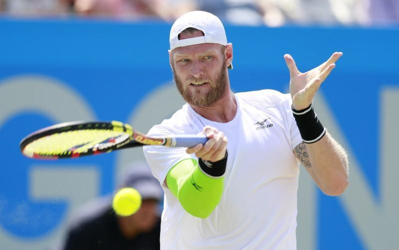 Australia's Sam Groth in action during his semi final match against Italy's Thomas Fabbiano