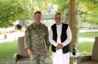 U.S. Army Gen. Austin Miller, the U.S.'s top general in Afghanistan, meets Afghan President Ashraf Ghani at the presidential palace in Kabul, Afghanistan, Friday July 2, 2021. After nearly 20 years, the U.S. military left Bagram Airfield, the epicenter of its war to oust the Taliban and hunt down the al-Qaida perpetrators of the 9/11 terrorist attacks on America, two U.S. officials said Friday. (Presidential Palace via AP)