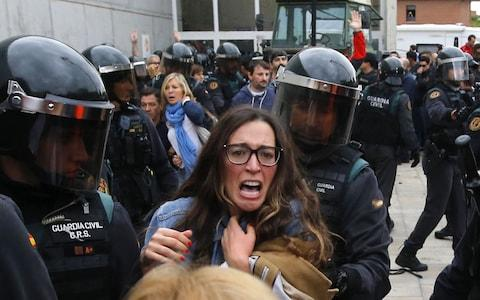 People clash with Spanish Guardia Civil guards - Credit: RAYMOND ROIG/AFP/Getty Images