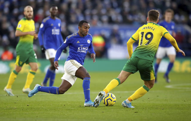 Leicester City's Ricardo Pereira, left, and Norwich City's Tom Trybull in action during their English Premier League soccer match at King Power Stadium in Leicester, England, Saturday Dec. 14, 2019. (Nick Potts/PA via AP)