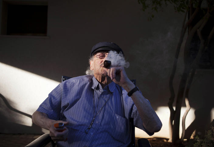 In this photograph made on Tuesday, Oct. 30, 2012, Moshe Rute, 80, smokes medical cannabis at the old age nursery home in kibbutz Naan next to the city of Rehovot, Israel. Marijuana is illegal in Israel but medical use has been permitted since the early nineties for cancer patients and those with pain-related illnesses such as Parkinson's, Multiple Sclerosis, and even post-traumatic stress disorder. (AP Photo/Dan Balilty)