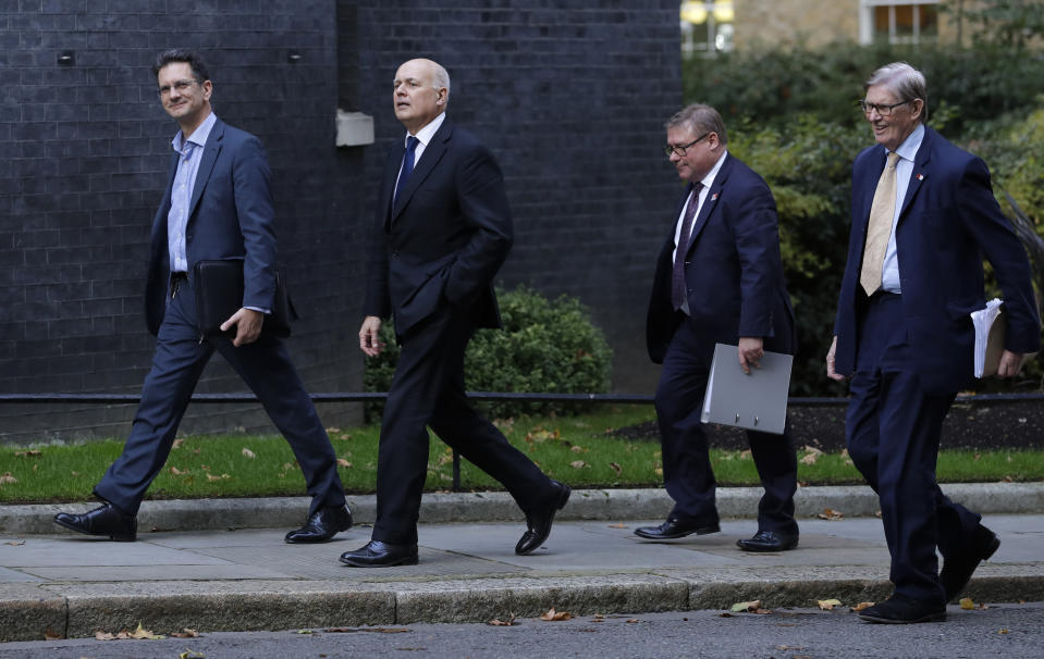 Britain's Conservative Party politicians, from left, Steve Baker, Iain Duncan Smith, Mark Francois, and Bill Cash, walk up Downing Street for a meeting, in London, Wednesday, Oct. 16, 2019.  Talks between the EU and Britain on the country's departure from the bloc are continuing after running through the night but that obstacles remain. (AP Photo/Kirsty Wigglesworth)