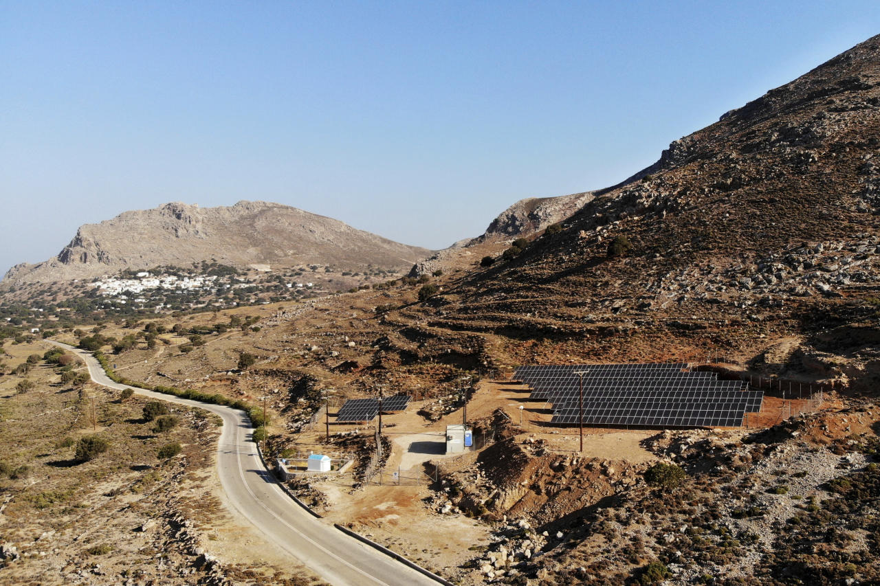 In this Thursday, Aug. 9, 2018, photo is seen a solar park on the Aegean island of Tilos, Greece. Tilos with its winter population of 400 and summer population of some 3000, will become the first island in the Mediterranean to run exclusively on wind and solar power when the blades of the 800 kilowatt wind turbine start turning. (AP Photo/ Iliana Mier)