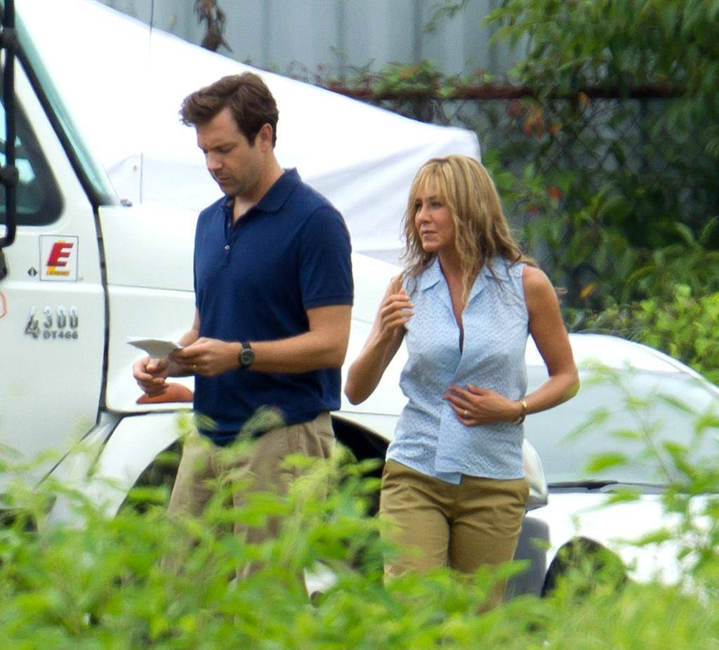 "<b>Bra Bearer<br>  <br> </b>Jennifer Aniston, 43, is seen in costume on the  Wilmington, North Carolina, set of the comedy ""We're The Millers."" The  film, also starring Jason Sudeikis (left), revolves around a pot dealer who  creates a fake family in an attempt to move a large shipment of  marijuana from the U.S. to Mexico."