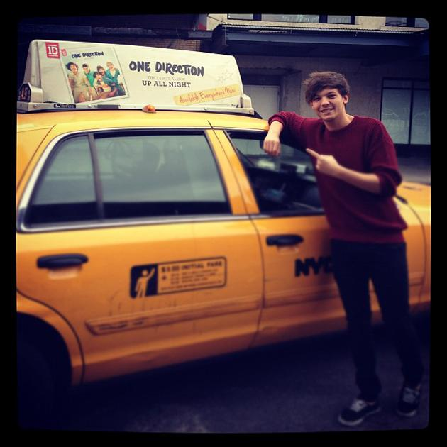 Celebrity photos: When Louis Tomlinson saw an advert for One Direction's album on the top of an American taxi, he had to stop to capture the moment.
