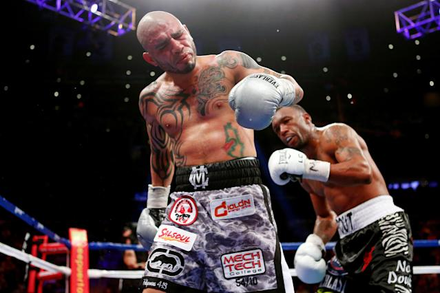 NEW YORK, NY - DECEMBER 01: Miguel Cotto reacts after a low blow from Austin Trout in their WBA Super Welterweight Championship title fight at Madison Square Garden on December 1, 2012 in New York City. (Photo by Elsa/Getty Images)