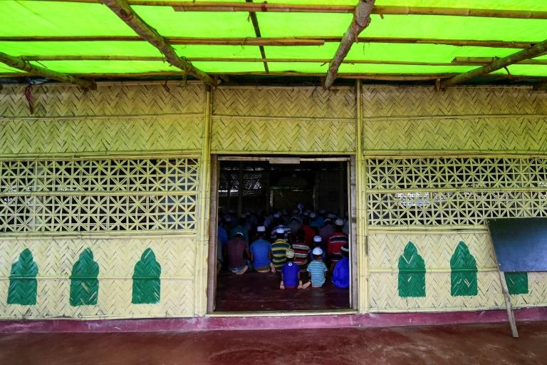 Rohingya Muslim refugees pray at a mosque in the Kutupalong refugee camp in Bangladesh