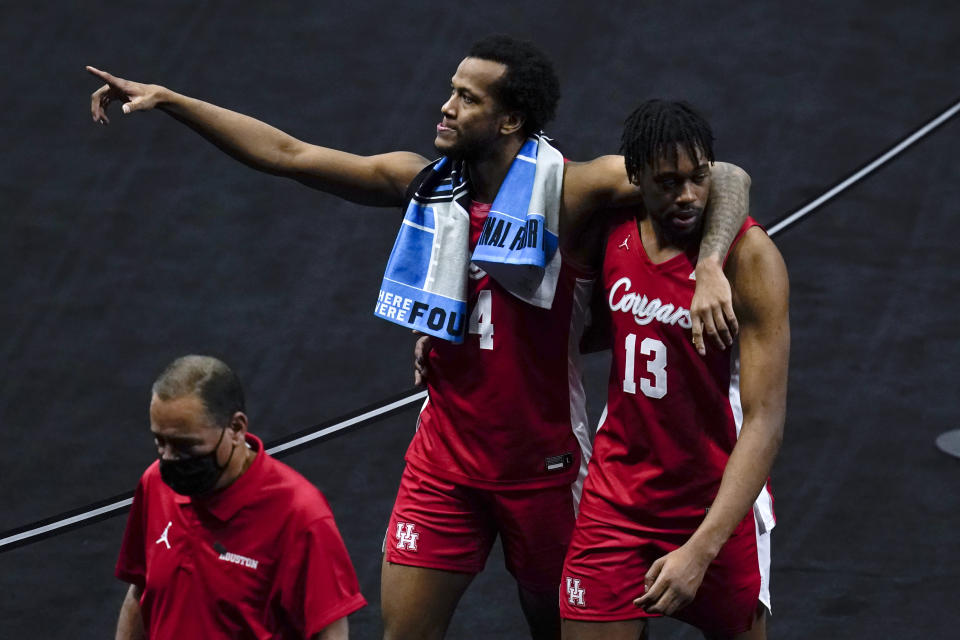 Houston forward Justin Gorham, left, walks off the court with teammate forward J'Wan Roberts (13) at the end of a men's Final Four NCAA college basketball tournament semifinal game against Baylor, Saturday, April 3, 2021, at Lucas Oil Stadium in Indianapolis. Baylor won 78-59. (AP Photo/Michael Conroy)