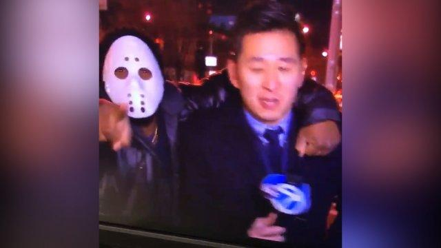 Reporter attacked by man in hockey mask