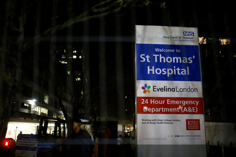 A police officer is seen in the St Thomas' Hospital after British Prime Minister Boris Johnson was moved to intensive care
