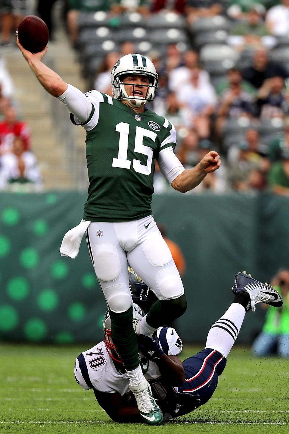 <p>Josh McCown #15 of the New York Jets thows the ball in the first quarter against the New England Patriots during their game at MetLife Stadium on October 15, 2017 in East Rutherford, New Jersey. (Photo by Abbie Parr/Getty Images) </p>