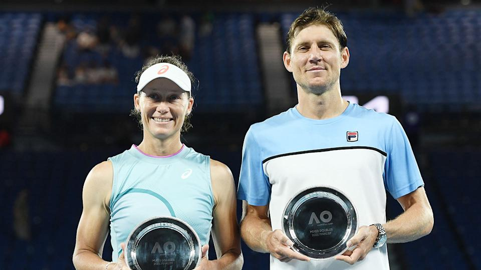 Seen here, Sam Stosur and Matthew Ebden pose with their Australian Open mixed doubles runner-up plates.