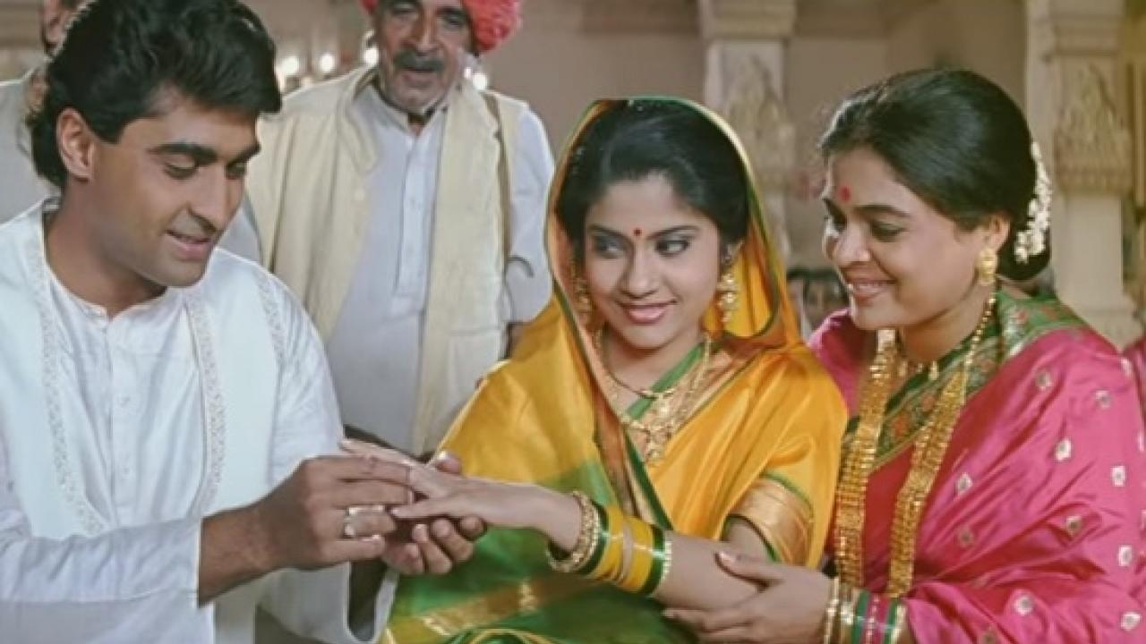 "<p>Sorry, but this movie is insufferable. I absolutely loved ""Nadia ke Paar"", from which the plot of ""Hum Aapke Hai Kaun"" was picked – though, I have my disagreements with the storyline there also. However, given the rural backdrop of ""Nadia ke Paar"", I get why a coy village belle would hesitate confronting her parents, but Nisha was a city girl, too smart to nod to a forced marriage. Again this idea of getting the little sister married to a deceased sister's husband for the child/children's sake has been employed in many Bollywood movies and I don't understand how the audience even accepts such utter absurdity, let alone making it a blockbuster. </p>"