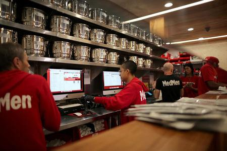 FILE PHOTO: Employees prepare recreational marijuana orders for customers at the MedMen store in West Hollywood, California, U.S., January 2, 2018.   REUTERS/Lucy Nicholson/File Photo
