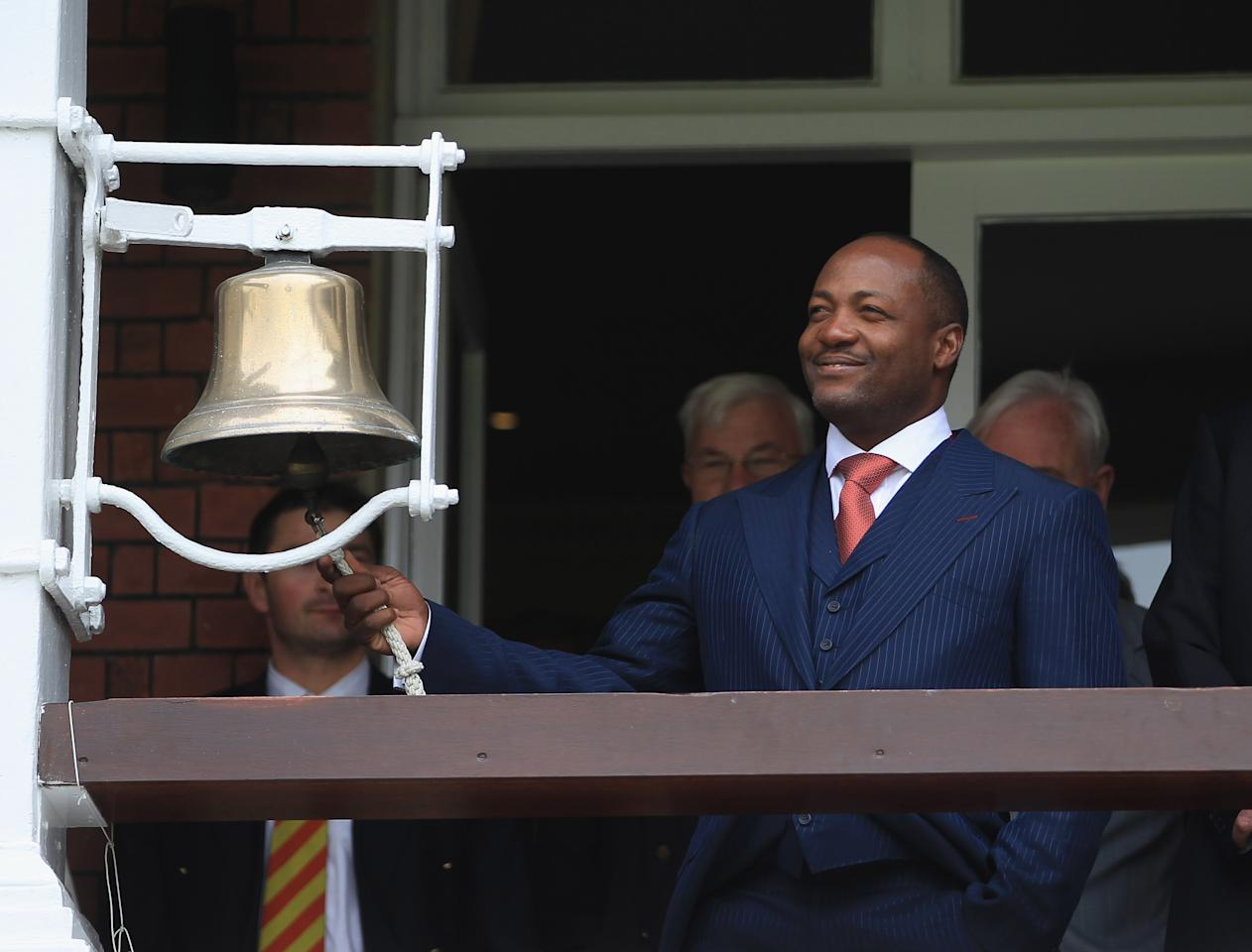 LONDON, ENGLAND - MAY 18:  Brian Lara of the West Indies rings the bell at the start of play during day 2 of the 1st Investec Test Match between England and West Indies at Lord's Cricket Ground on May 18, 2012 in London, England.  (Photo by Tom Shaw/Getty Images)