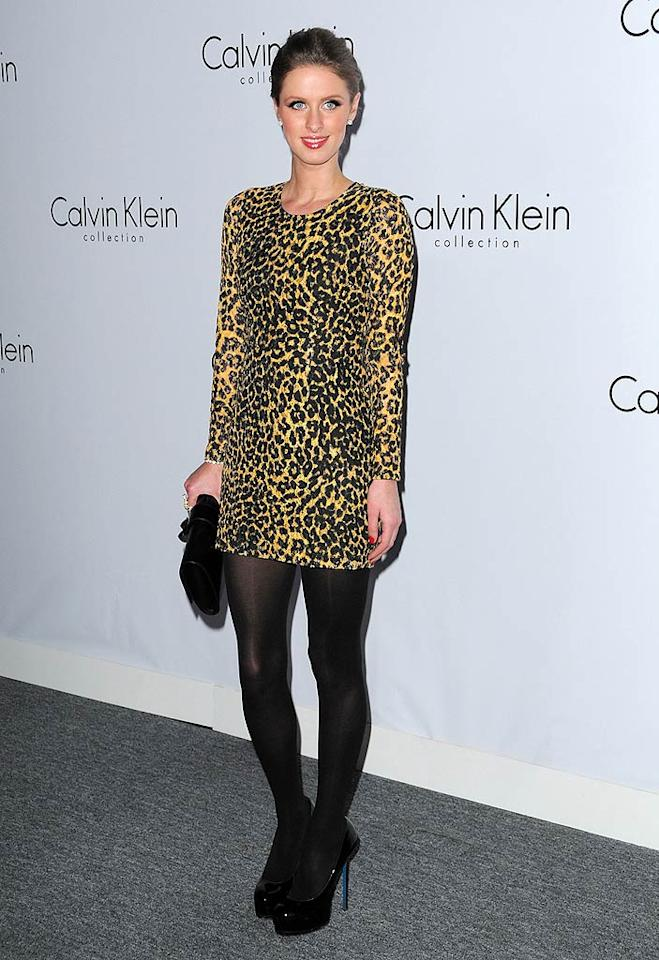"""Hotel heiress Nicky Hilton also bucked the muted color trend by rocking a leopard-print mini. Jordan Strauss/<a href=""""http://www.wireimage.com"""" target=""""new"""">WireImage.com</a> - January 28, 2010"""