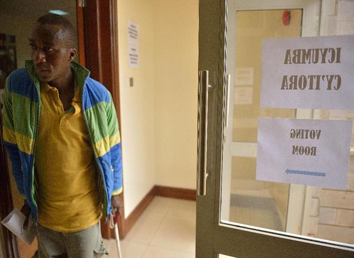 A man walks enters a voting booth at a polling station at the Rwandan High Commission in Nairobi on December 17, 2015 (AFP Photo/Tony Karumba)