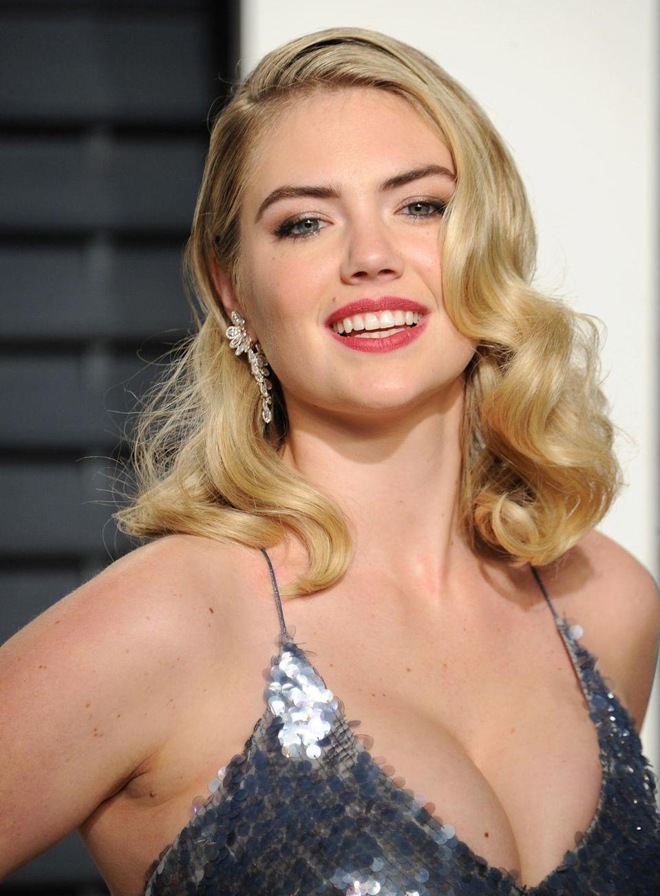 <p>Old Hollywood curls complement round faces because they always fall in the perfect place. Kate Upton is giving major Marilyn Monroe vibes. </p>