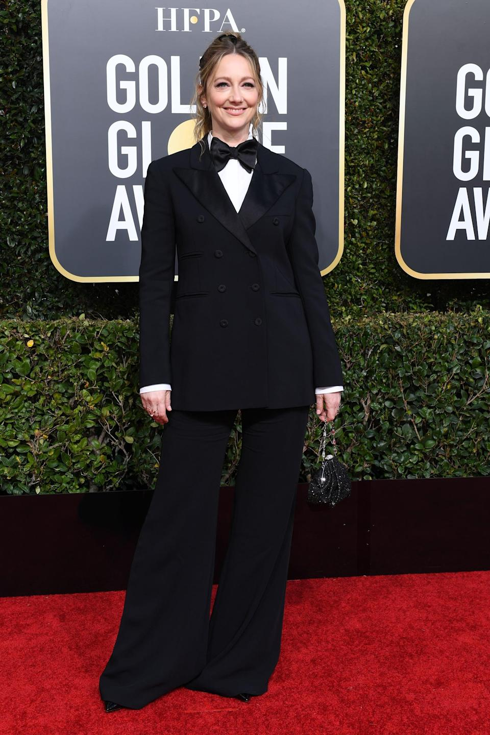 <p>Wearing an Alberta Ferretti suit over a COS shirt with Kallati jewelry, Stella Luna shoes, and a Judith Leiber bag.</p>