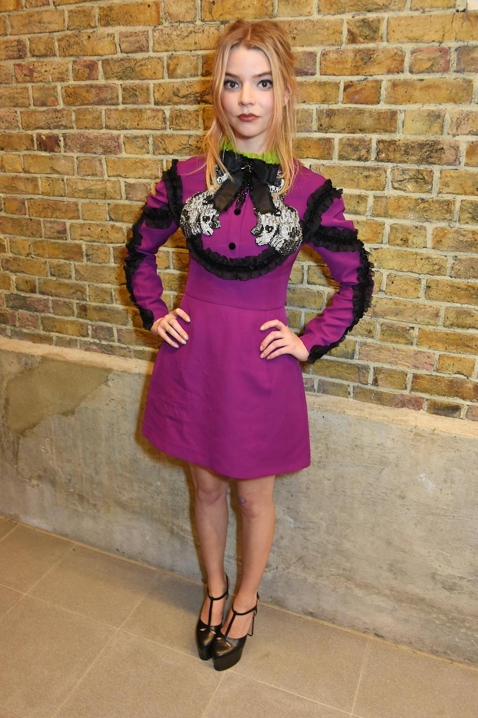 <p>Anya chose yet another little Gucci dress with a bow at the neck.</p>