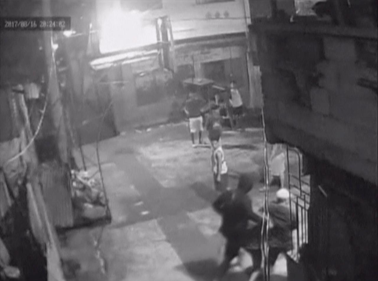 CCTV footage appearing to show Kian Loyd Delos Santos being dragged by plain-clothed police past a basketball court in Caloocan City Barangay, Philippines August 16, 2017 in this still image taken from video.  CALOOCAN CITY BARANGAY 160/Handout via Reuters TV  ATTENTION EDITORS - THIS IMAGE HAS BEEN SUPPLIED BY A THIRD PARTY. NO RESALES. NO ARCHIVE.