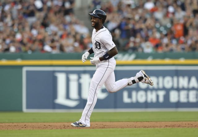 Detroit Tigers' Niko Goodrum rounds the bases after his two-run home run during the fourth inning of a baseball game against the Minnesota Twins, Friday, Aug. 10, 2018, in Detroit. (AP Photo/Carlos Osorio)