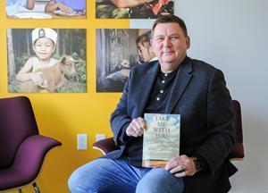 """Scott Jackson with his rereleased book, """"Take Me With You"""""""