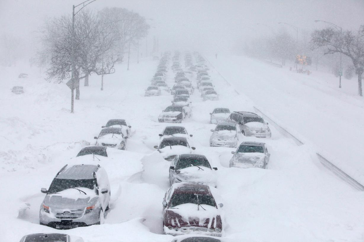 FOR USE AS DESIRED, YEAR END PHOTOS - FILE -In this Feb. 2, 2011 file photo, hundreds of cars are seen stranded on lake Shore drive in Chicago. A winter blizzard of historic proportions wobbled an otherwise snow-tough Chicago, stranding hundreds of drivers for up to 12 hours overnight on the city's showcase lakeshore thoroughfare and giving many city schoolchildren their first ever snow day. (AP Photo/Kiichiro Sato, File)