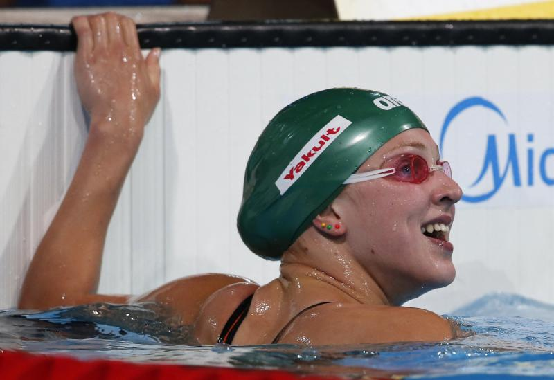 Lithuania's Ruta Meilutyte smiles after she completed a Women's 100m breaststroke heat at the FINA Swimming World Championships in Barcelona, Spain, Monday, July 29, 2013. (AP Photo/Michael Sohn)