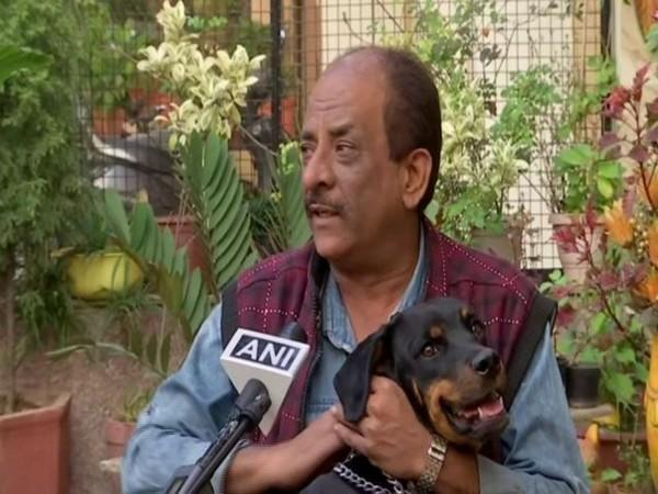 A pet-owner in Chandigarh on Saturday. (Photo/ANI)