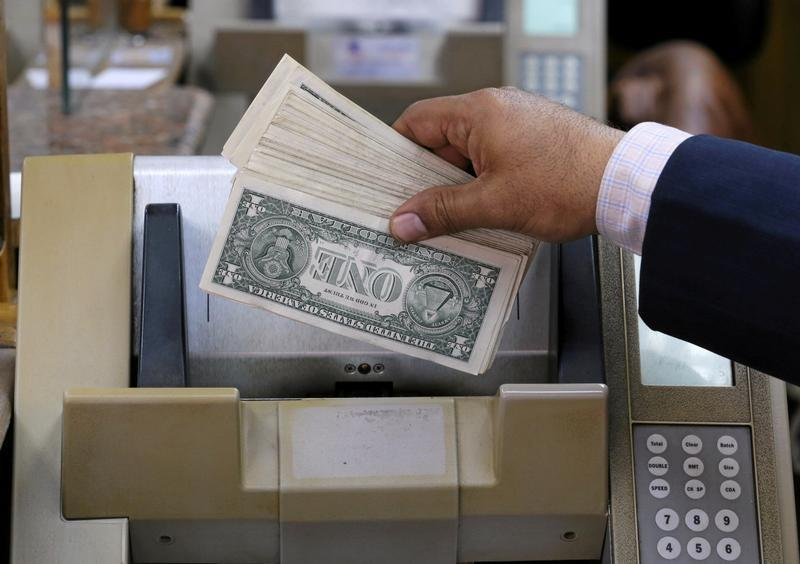 An Employee Counts U S Dollars In A Foreign Exchange Office Central Cairo