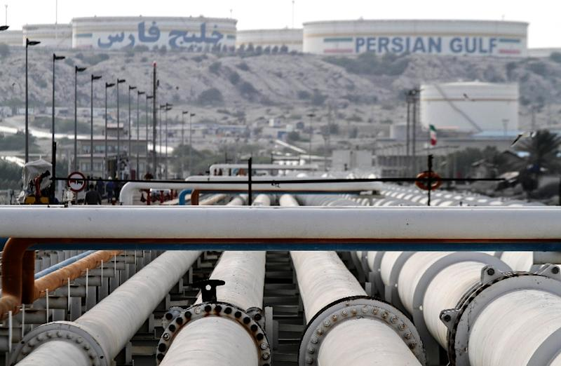 Snaps back Iran sanctions, grants oil waivers to India, seven others