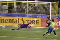 Seattle Sounders' Kelvin Leerdam, right, kicks a goal against San Jose Earthquakes goalkeeper Daniel Vega, left, and Florian Jungwirth, second from right, during the first half of an MLS soccer match Thursday, Sept. 10, 2020, in Seattle. (AP Photo/Ted S. Warren)