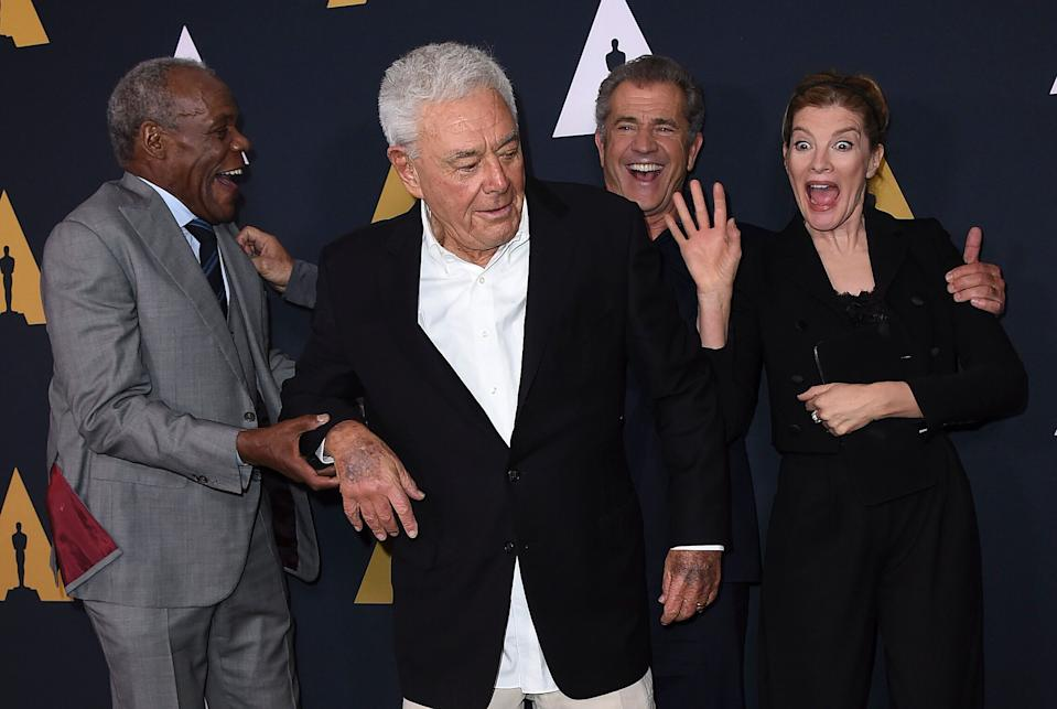 Danny Glover, Richard Donner, Mel Gibson and Rene Russo, from left, arrive at the Richard Donner Tribute Wednesday, June 7, 2017 in Beverly Hills, Calif. (Photo by Jordan Strauss/Invision/AP)