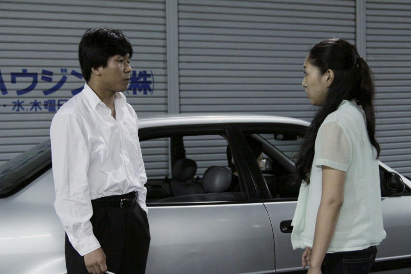 "In this undated photo released on Saturday, Oct. 6 2012 by Busan International Film Festival, Japanese actress Sakura Ando and South Korean actor Yun Sung-ho act in a scene from the movie ""Our Homeland"" in Japan. Korean-Japanese filmmaker Yang Yonghi says she leaned on her own personal history and similar stories from her pro-North Korean community in Japan for her latest movie, which made its South Korean debut Saturday, Oct. 6, 2012 at the Busan International Film Festival. (AP Photo/Busan International Film Festival) EDITORIAL USE ONLY"