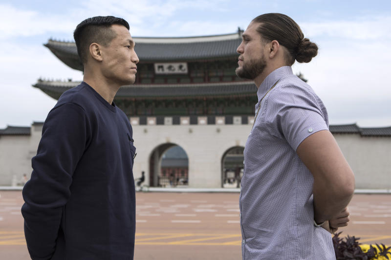 SEOUL, SOUTH KOREA - OCTOBER 17: Brian Ortega(right) and Chan Sung Jung also known as Korean Zombie face off in front of Gwanghwamun in Seoul, South Korea on October 17, 2019 ahead of the mixed martial arts event produced by the Ultimate Fighting Championship that is planned to take place in December in Busan, Korea. (Photo by Woohae Cho/Zuffa LLC)